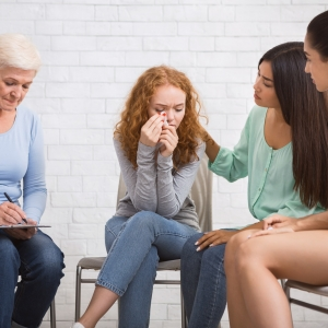Diverse Ladies Supporting Girl Crying During Group Psychotherapy Indoor