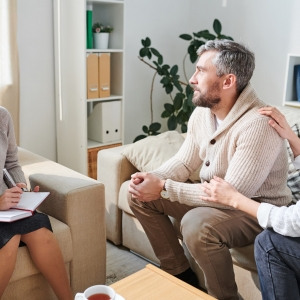 Husband in depression visiting with wife to psychologist