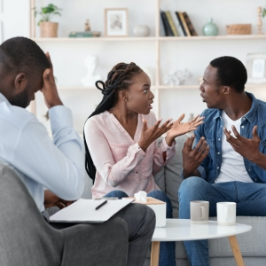 Marriage crisis. Young black spouses arguing at family therapy session